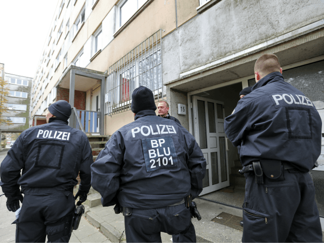 Policemen stand in front of a house at the Neu Zippendorf district in Schwerin, northeastern Germany, where a 19-year-old Syrian man suspected of planning an Islamist bomb attack was arrested on October 31, 2017. The man, identified only as Yamen A, was held at dawn by special forces, suspected of …