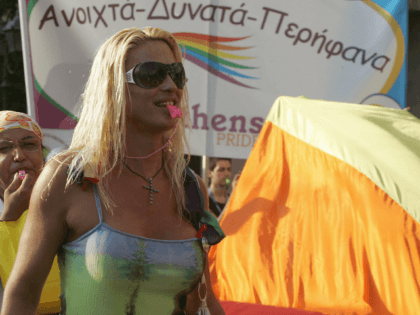 Athens, GREECE: Athenian gays and lesbians parade in the city during the 2nd Athens Gay Pride in the Greek capital 24 June 2006. Thousands of demonstrators took to the streets of the city calling for the right to civil marriage for same-sex couples. AFP PHOTO/LOUISA GOULIAMAKI (Photo credit should read …