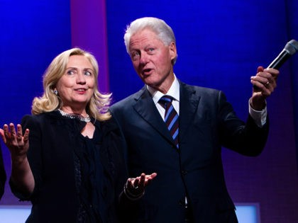 NEW YORK CITY- SEPTEMBER 22: Former US President Bill Clinton (R) stands on stage with his wife Hillary Rodham Clinton (C), Secretary of State, and their daughter Chelsea Clinton during the closing Plenary session of the seventh Annual Meeting of the Clinton Global Initiative (CGI) at the Sheraton New York …