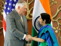 Indian Foreign Minister Sushma Swaraj, right, shakes hand with U.S. Secretary of State Rex Tillerson in New Delhi, India, Wednesday, Oct. 25, 2017. (AP Photo/Manish Swarup)