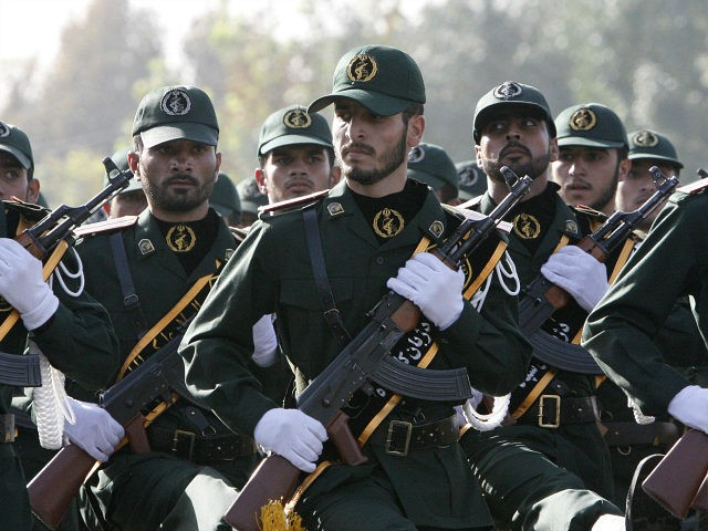In this picture taken on Sunday, Sept. 21, 2008, Iranian Revolutionary Guards members march during a parade ceremony, marking the 28th anniversary of the onset of the Iran-Iraq war (1980-1988), in front of the mausoleum of the late revolutionary founder Ayatollah Ruhollah Khomeini, just outside Tehran, Iran. Speaking to Arab students at Carnegie Mellon's Doha campus, US Secretary of State Hillary Rodham Clinton said Monday, Iran's Revolutionary Guard Corps appears to have gained so much power that it effectively is supplanting the Iranian government. (AP Photo/Vahid Salemi)
