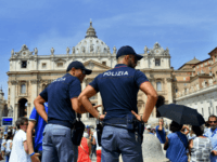 Italian police officers stand guard by people gathered in St. Peter's at the Vatican during Pope Francis Sunday Angelus prayer on July 24, 2016. / AFP / FILIPPO MONTEFORTE (Photo credit should read FILIPPO MONTEFORTE/AFP/Getty Images)