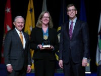 U.S. Attorney General Jeff Sessions (L) poses for a photograph with Justice Department Civil Division Appellate Staff Assistant Director Sharon Swingle (C) during the 65th Annual Attorney General's Awards Ceremony at the Daughters of the American Revolution Constitution Hall October 25, 2017 in Washington, DC. Swingle was given The Attorney …