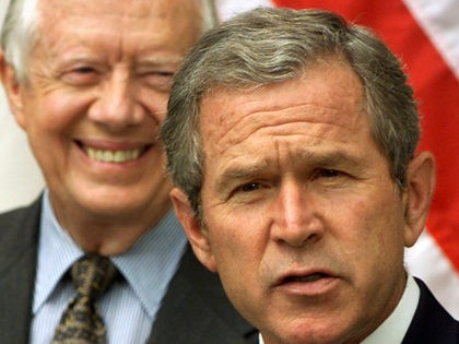 In a Rose Garden ceremony at the White House, Tuesday, July 31, 2001, President Bush and former President Carter talk about a long-awaited report on how to improve America's voting system. The study was headed by Carter, left and former President Gerald Ford, not pictured.(AP Photo/J. Scott Applewhite)