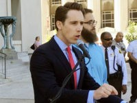In this June 21, 2017 file photo, Missouri Attorney General Josh Hawley speaks at a news conference in St. Louis. Missouri Democrats recently launched digital ads accusing potential Republican U.S. Senate candidate Josh Hawley of being financially irresponsible as attorney general, Friday, Aug. 11, 2017. (AP Photo/Jim Salter, File)