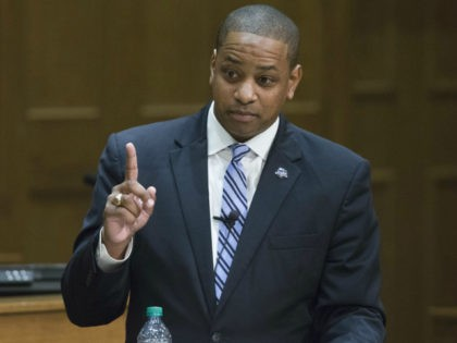 In this Thursday Oct. 5, 2017 photo Democrat Justin Fairfax gestures during a debate with Republican Virginia State Sen. Jill Vogel, right, at the University of Richmond in Richmond, Va. Fairfax, a former federal prosecutor, and Vogel, a state senator from Fauquier County, are running for lieutenant governor in next …