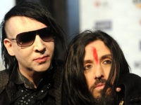 Musicians Marilyn Manson (L) and Twiggy Ramirez arrive at the 5th annual �Scream Awards� at the Greek Theatre in Los Angeles, California on October 16, 2010. AFP PHOTO / GABRIEL BOUYS (Photo credit should read GABRIEL BOUYS/AFP/Getty Images)