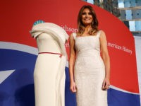 First lady Melania Trump donates her inaugural gown, designed by Herve Pierre, to the First Ladies' Collection at the Smithsonian's National Museum of American History, during a ceremony in Washington, Friday, Oct. 20, 2017. (AP Photo/Pablo Martinez Monsivais