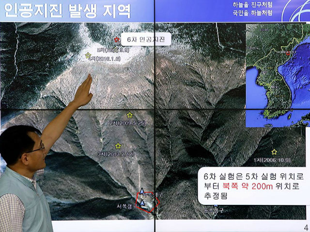 A South Korean scientist shows seismic waves taking place in North Korea on a screen at the Korea Meteorological Administration center on September 3, 2017 in Seoul. More than 200 people are believed to have died in underground tunnels after a collapse at North Korea's Punggye-ri nuclear facility. CHUNG SUNG-JUN/GETTY IMAGES