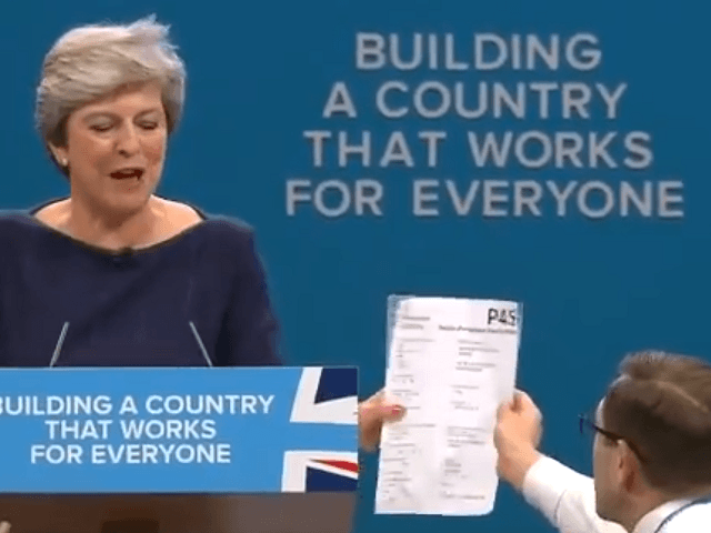 Theresa May's speech overshadowed by a persistent cough and a prankster