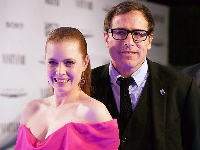 WEST HOLLYWOOD, CA - FEBRUARY 27: Amy Adams and David O. Russell arrive for the Vanity Fair Campaign Hollywood 'American Hustle' Toast Sponsored By Chrysler - Arrivals at Ago Restaurant on February 27, 2014 in West Hollywood, California. (Photo by Gabriel Olsen/Getty Images)