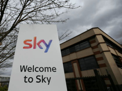 A Sky logo is pictured on a sign next to the entrance to pay-TV giant Sky Plc's headquarters in Isleworth, west London on March 17, 2017. A proposed multi-billion takeover bid for European pay-TV giant Sky by 21st Century Fox will be probed by media watchdog Ofcom and the Competition …