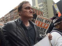 "FILE - In this Oct. 24, 2015 file photo, director Quentin Tarantino, center, participates in a rally to protest against police brutality in New York. Speakers at the protest said they want to bring justice for those who were killed by police. Tarantino's new film, ""The Hateful Eight,"" opens in …"
