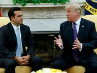 President Donald Trump meets with Governor Ricardo Rossello of Puerto Rico in the Oval Office of the White House, Thursday, Oct. 19, 2017, in Washington. (AP Photo/Evan Vucci)