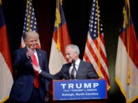 resumptive Republican presidential nominee Donald Trump stands next to Sen. Bob Corker (R-TN) during a campaign event at the Duke Energy Center for the Performing Arts on July 5, 2016 in Raleigh, North Carolina. Earlier in the day Hillary Clinton campaigned in Charlotte, North Carolina with President Barack Obama. (Photo …