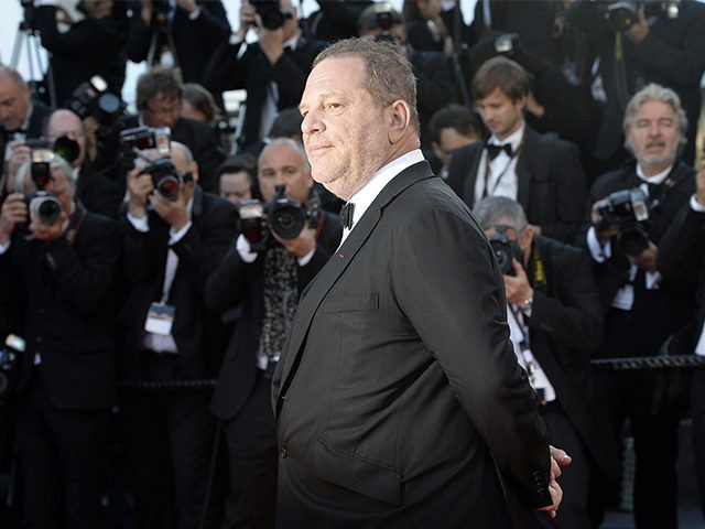 US producer Harvey Weinstein poses on May 24, 2013 as he arrives for the screening of the film 'The Immigrant' presented in Competition at the 66th edition of the Cannes Film Festival in Cannes. Cannes, one of the world's top film festivals, opened on May 15 and will climax on …