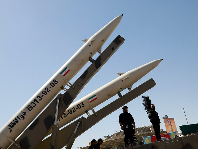Zolfaghar missiles (R) are displayed during a rally marking al-Quds (Jerusalem) Day in Tehran on June 23, 2017. Chants against the Saudi royal family and the Islamic State group mingled with the traditional cries of 'Death to Israel' and 'Death to America' at Jerusalem Day rallies across Iran today. / …