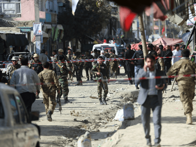 Security forces inspect the site of a suicide attack outside a Shiite mosque in Kabul, Afghanistan, Friday, Sept. 29, 2017. A suicide bomber blew himself up outside a Shiite mosque in the Afghan capital Kabul on Friday, killing four people and wounding 20 others, authorities said. (AP Photo/Massoud Hossaini)