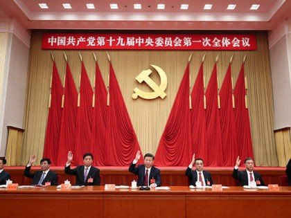 BEIJING, Oct. 25, 2017 -- Xi Jinping (C), Li Keqiang (3rd R), Li Zhanshu (3rd L), Wang Yang (2nd R), Wang Huning (2nd L), Zhao Leji (1st R) and Han Zheng (1st L) attend the first plenary session of the 19th Communist Party of China (CPC) Central Committee at the …