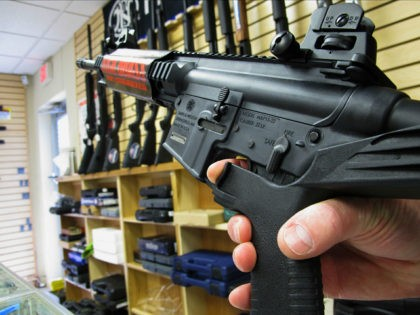 "FILE - In this Feb. 1, 2013, file photo, an employee of North Raleigh Guns demonstrates how a ""bump"" stock works at the Raleigh, N.C., shop. The gunman who unleashed hundreds of rounds of gunfire on a crowd of concertgoers in Las Vegas on Monday, Oct. 2, 2017, attached what …"