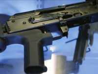 "In this Oct. 4, 2017, photo, a device called a ""bump stock"" is attached to a semi-automatic rifle at the Gun Vault store and shooting range in South Jordan, Utah. The National Rifle Association announced its support Ton Oct. 5 for regulating the devices that can effectively convert semi-automatic rifles …"