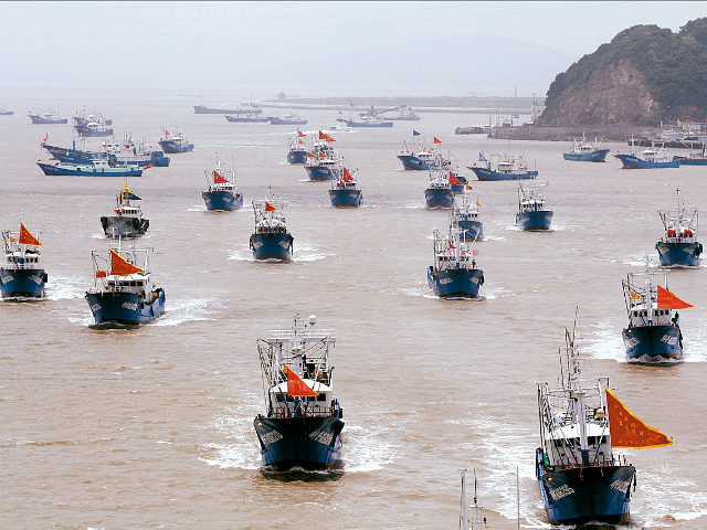 ZHOUSHAN, CHINA - AUGUST 01: Fishing boats set sail to East China Sea for fishing on August 1, 2017 in Zhoushan, Zhejiang Province of China. About 3575 fishing boats set off from Shenjiamen fishing harbor from 12 pm Tuesday in Zhoushan. They will sail to the East China Sea for …