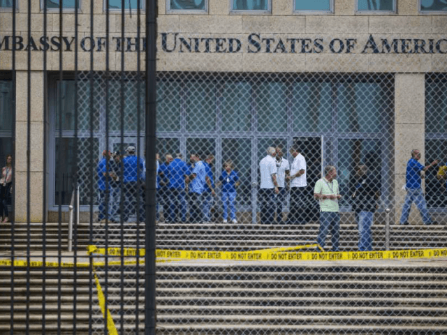 FILE - In a Friday, Sept. 29, 2017 file photo, staff stand within the United States embassy facility in Havana, Cuba. The terrifying attacks in Cuba overwhelmingly hit U.S. intelligence operatives in Havana, not ordinary diplomats, when they began within days of President Donald Trump's election, The Associated Press has …