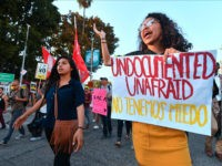 Young immigrants, activists and supporters of the DACA program march through downtown Los Angeles, California on September 5, 2017 after the Trump administration formally announced it will end the DACA (Deferred Action for Childhood Arrivals) program, giving Congress six months to act. US President Donald Trump ended an amnesty protecting 800,000 people brought to the US illegally as minors from deportation. 'I am here today to announce that the program known as DACA that was effectuated under the Obama Administration is being rescinded,' US Attorney General Jeff Sessions announced. / AFP PHOTO / FREDERIC J. BROWN (Photo credit should read FREDERIC J. BROWN/AFP/Getty Images)