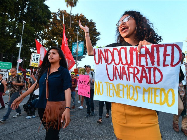 Young immigrants, activists and supporters of the DACA program march through downtown Los Angeles, California on September 5, 2017 after the Trump administration formally announced it will end the DACA (Deferred Action for Childhood Arrivals) program, giving Congress six months to act. US President Donald Trump ended an amnesty protecting …