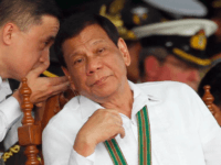 FILE - In this Oct. 5, 2017 file photo, Philippine President Rodrigo Duterte, right, listens to Special Assistant to the President Christopher Bong Go, during the change of command ceremony for the new army chief Maj. Gen. Rolando Joselito Bautista in Fort Bonifacio in, Taguig city, east of Manila, Philippines. …