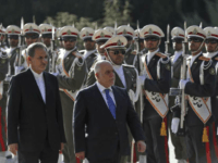 Iraqi Prime Minister Haider al-Abadi, center, reviews an honor guard as he is accompanied by Iranian Senior Vice-President Eshaq Jahangiri, during an official welcoming ceremony for him at the Saadabad Palace in Tehran, Iran, Thursday, Oct. 26, 2017. Haider al-Abadi is in Iran after recent stops in Turkey and Jordan, and meetings with U.S. officials and allies eager to pull Baghdad into their political orbit. (AP Photo/Vahid Salemi)