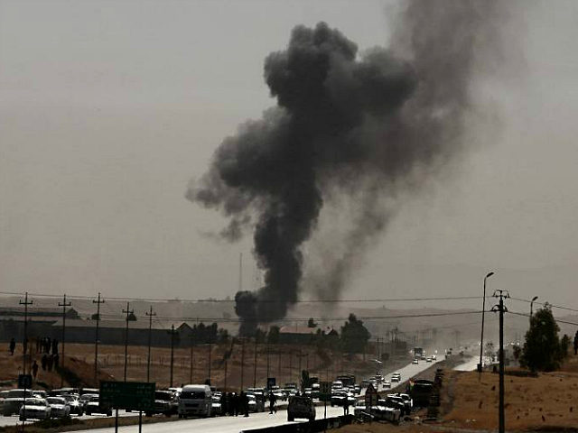 Smoke rises while Iraqi security forces use bombs as Kurdish security forces withdraw from a checkpoint in Altun Kupri, outskirts of Irbil, Iraq, Friday Oct. 20, 2017. Iraqi federal and Kurdish forces exchanged fire at their shared border on Friday, capping a dramatic week of maneuvers that saw the Kurds hand over territory across northern Iraq. (AP Photo/Khalid Mohammed)