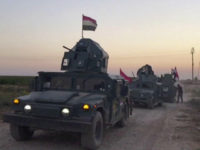 This image made from a video shows Iraqi soldiers on military vehicles in the Qatash area towards Kirkuk gas plant, south of Kirkuk, Iraq, Monday, Oct. 16, 2017. Iraqi state media say federal troops have entered disputed territories occupied by the nation's Kurds. The move comes three years after Kurdish …