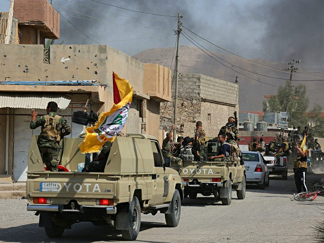 Iraqi security forces and Popular Mobilization Forces patrol in Tuz Khormato, that was evacuated by Kurdish security forces, 130 miles (210 kilometers) north of Baghdad, Iraq, Monday, Oct. 16, 2017. Two weeks after fighting together against the Islamic State, Iraqi forces pushed their Kurdish allies out of the disputed city of Kirkuk on Monday, seizing oil fields and other facilities amid soaring tensions over last month's Kurdish vote for independence. (AP Photo)