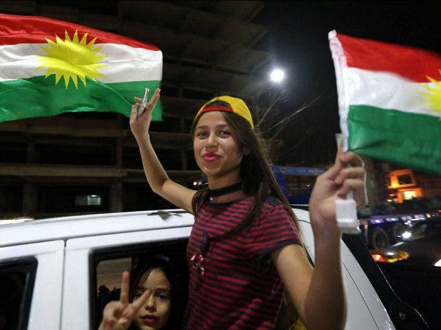 Iraqi Kurds wave the Kurdish flag as they celebrate the independence referendum in the streets of the northern city of Arbil on September 27, 2017 in Iraq's autonomous northern Kurdish region. Official results showed 92.73 percent of voters backing statehood in Monday's non-binding referendum, which Iraq's central government rejected as …