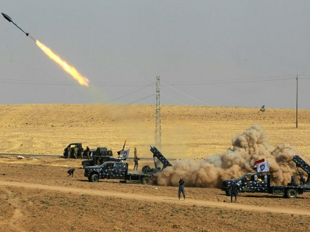 A picture taken on October 26, 2017 shows rockets being launched from Iraqi security forces' against Kurdish Peshmerga positions in the area of Faysh Khabur, which is located on the Turkish and Syrian borders in the Iraqi Kurdish autonomous region. / AFP PHOTO / AHMAD AL-RUBAYE (Photo credit should read …