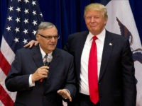 FILE - In this Jan. 26, 2016 file photo, then-Republican presidential candidate Donald Trump is joined by Joe Arpaio, the sheriff of metro Phoenix, at a campaign event in Marshalltown, Iowa. President Donald Trump has pardoned former sheriff Joe Arpaio following his conviction for intentionally disobeying a judge's order in …