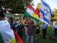 Members of the Kurdish Jewish community hold Kurdish and Israeli flags during a demonstration near the American consulate in Jerusalem on September 24, 2017, in support of the referendum on independence in Iraq's autonomous Kurdish region, the day before voting polls open. / AFP PHOTO / AHMAD GHARABLI (Photo credit should read AHMAD GHARABLI/AFP/Getty Images)