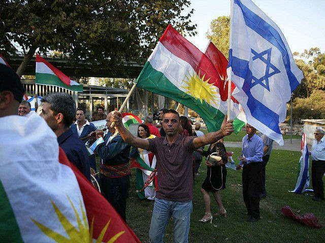 Members of the Kurdish Jewish community hold Kurdish and Israeli flags during a demonstration near the American consulate in Jerusalem on September 24, 2017, in support of the referendum on independence in Iraq's autonomous Kurdish region, the day before voting polls open. / AFP PHOTO / AHMAD GHARABLI (Photo credit …