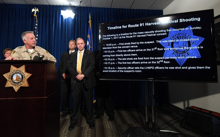 LAS VEGAS, NV - OCTOBER 04: (L-R) Clark County Sheriff Joe Lombardo shows a timeline of events from Sunday's mass shooting as U.S. Sen Dean Heller (R-NV) and FBI Las Vegas Division Special Agent in Charge Aaron Rouse look on during a news conference at the Las Vegas Metropolitan Police Department headquarters to brief members of the media on the mass shooting on October 4, 2017 in Las Vegas, Nevada. On October 1, Stephen Paddock killed at least 58 people and injured more than 450 after he opened fire on a large crowd at the Route 91 Harvest country music festival. The massacre is one of the deadliest mass shooting events in U.S. history. (Photo by Ethan Miller/Getty Images)