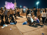 LAS VEGAS, NV - OCTOBER 01: People tend to the wounded outside the Route 91 Harvest Country music festival grounds after an apparent shooting on October 1, 2017 in Las Vegas, Nevada. There are reports of an active shooter around the Mandalay Bay Resort and Casino. David Becker/Getty
