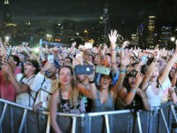 In this Aug 5, 2017, file photo, concertgoers attend day 3 of Lollapalooza in Grant Park on in Chicago. Stephen Paddock, opened fire on an outdoor music concert on Sunday, Oct. 1, killing dozens and injuring hundreds in Las Vegas. In August, Paddock, booked a room at Chicago's Blackstone Hotel …