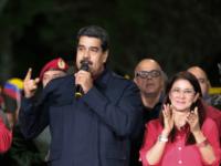 Venezuelan President Nicolas Maduro (R) speaks beside First lady Cilia Flores (R) and Diosdado Cabello (L), a member of the Constituent Assembly, in Caracas on October 15, 2017, after Maduro's socialist government won a landslide 17 out of 23 states in Venezuela's regional elections, according to official results announced by …