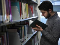 ISTANBUL, TURKEY - JANUARY 14: Amputee Syrian freelance cameraman Mohammad Kadour, who lost his leg after being shot by an Assad regime's soldier as he had been recording video for international TV channels, reads a book in library during an exclusive interview in Istanbul, Turkey on January 14, 2017. Currently, he continues his education in the department of Cinema and Television at Istanbul Sehir University in Istanbul, Turkey. Kadour told that he plans to turn-back to his home country after his graduation. (Photo by Arif Hudaverdi Yaman/Anadolu Agency/Getty Images)