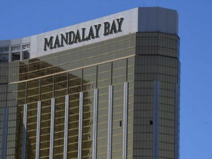 TOPSHOT - The damaged windows on the 32nd floor room that was used by the shooter in the Mandalay Hotel after a gunman killed at least 58 people and wounded more than 500 others when he opened fire on a country music concert in Las Vegas, Nevada on October 2, …