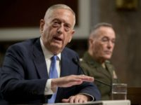 Defense Secretary Jim Mattis, left, accompanied by Joint Chiefs Chairman Gen. Joseph Dunford, speaks on Afghanistan before the Senate Armed Services Committee on Capitol Hill in Washington, Tuesday, Oct. 3, 2017. (AP Photo/Andrew Harnik)
