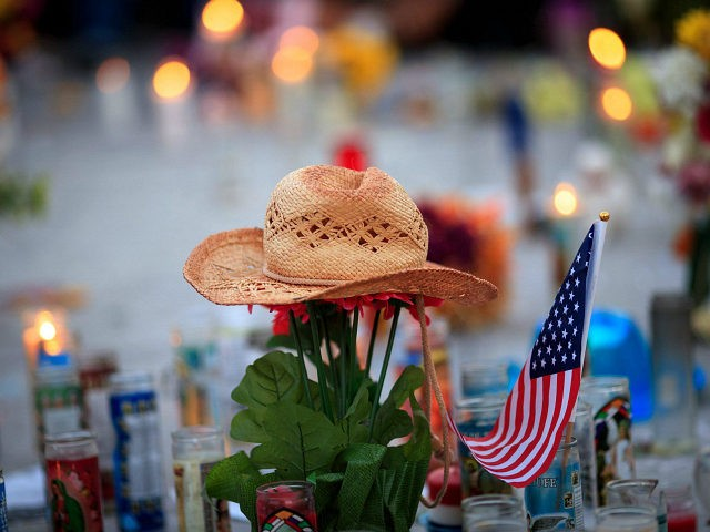LAS VEGAS, NV - OCTOBER 8: A hat is left at a makeshift memorial during a vigil to mark one week since the mass shooting at the Route 91 Harvest country music festival, on the corner of Sahara Avenue and Las Vegas Boulevard at the north end of the Las Vegas Strip, on October 8, 2017 in Las Vegas, Nevada. On October 1, Stephen Paddock killed 58 people and injured more than 450 after he opened fire on a large crowd at the Route 91 Harvest country music festival. The massacre is one of the deadliest mass shooting events in U.S. history. (Photo by Drew Angerer/Getty Images)