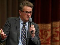 WASHINGTON, DC - JULY 12: MSNBC 'Morning Joe' host Joe Scarborough speaks during an interview with his co-host Mika Brzezinski and philanthropist and financier David Rubenstein during a Harvard Kennedy School Institute of Politics event in the McGowan Theater at the National Archives July 12, 2017 in Washington, DC. Scarborough and Brzezinski, who are engaged to be married, were recently attacked by President Donald Trump on Twitter, where he called the hosts 'Psycho Joe' and 'low I.Q. Crazy Mika,' among other personal insults. (Photo by Chip Somodevilla/Getty Images)