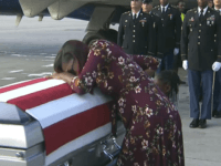 ADDS TRUMP'S RESPONSE TO REP. WILSON - In this Tuesday, Oct. 17, 2017, frame from video, Myeshia Johnson cries over the casket of her husband, Sgt. La David Johnson, who was killed in an ambush in Niger, upon his body's arrival in Miami. President Donald Trump told the widow that …