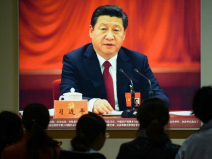 This picture taken on October 10, 2017 shows a portrait of Chinese President Xi Jinping at an exhibition showcasing China's progress in the past five years at the Beijing Exhibition Center. China's police and censorship organs have kicked into high gear to ensure that the party's week-long, twice-a-decade congress goes …